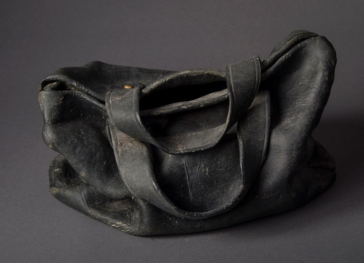 Picture of Black Satchel with Dust