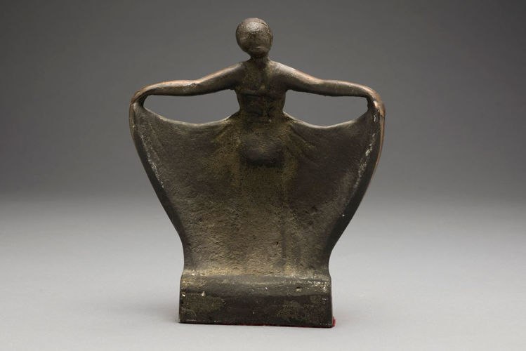 Picture of Woman Holding Her Dress Doorstop